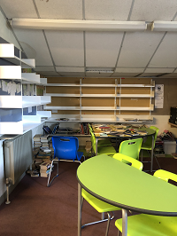 'Before - Our empty shelves when we started work.'